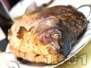 Рецепта Пълнен шаран за Никулден с ориз, орехи и стафиди